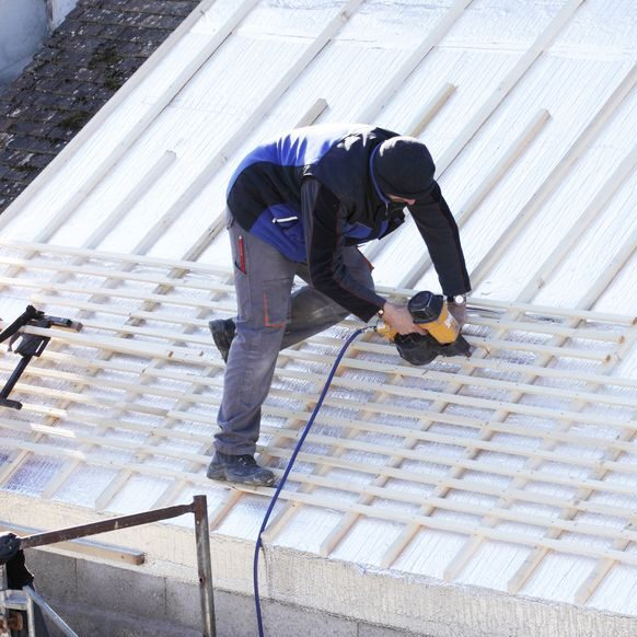 Roofer installing new roof