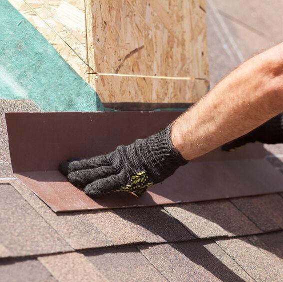 Man installing home shingles